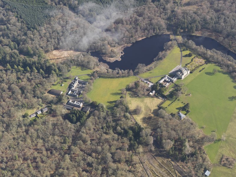 General oblique aerial view centred on the country house with the stables adjacent, taken from the WSW.
