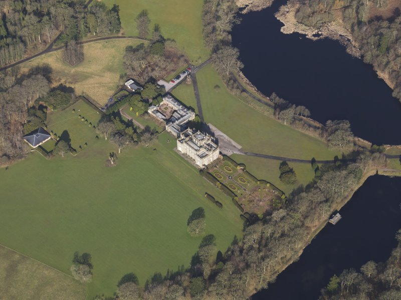 Oblique aerial view centred on the country house, taken from the ESE.