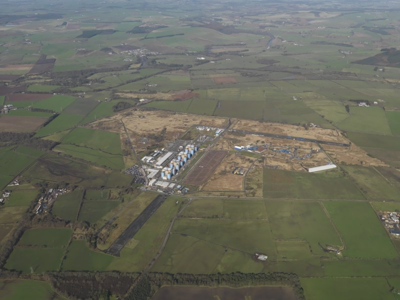 General oblique aerial view centred on the Nuclear power station with the airfield adjacent, taken from the E.