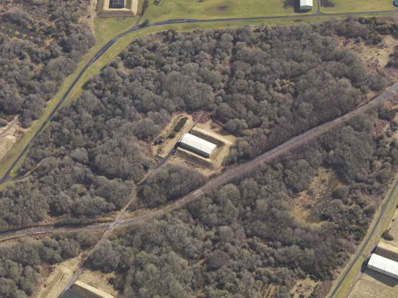 Oblique aerial view centred on a single bunker in the explosives works, taken from the SW.
