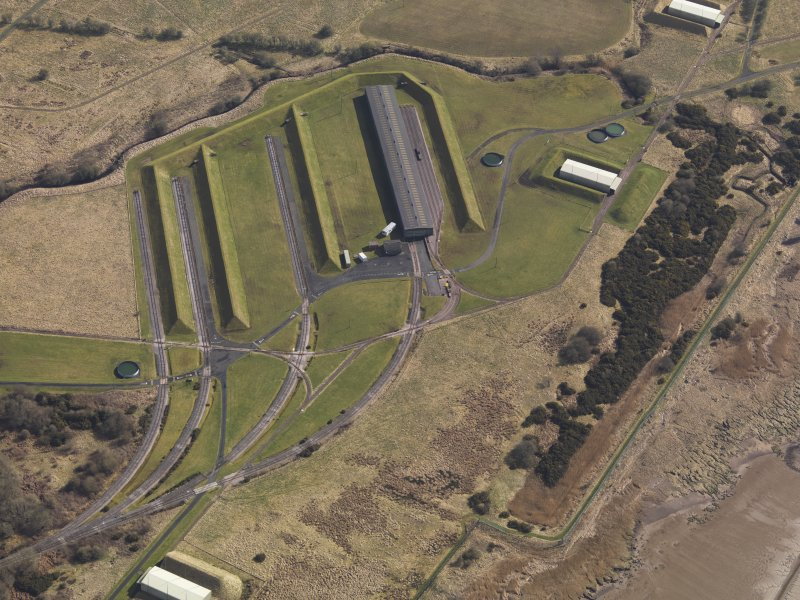 Oblique aerial view centred on the railway terminal in the explosives works, taken from the SW.