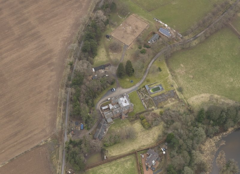 Oblique aerial view centred on the country house, taken from the WNW.