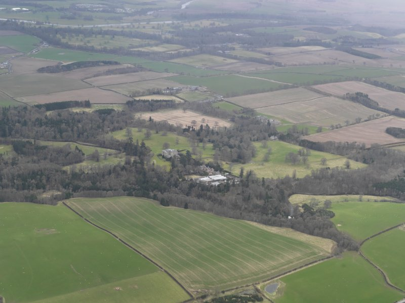 Oblique aerial view centred on the polices, taken from the N.