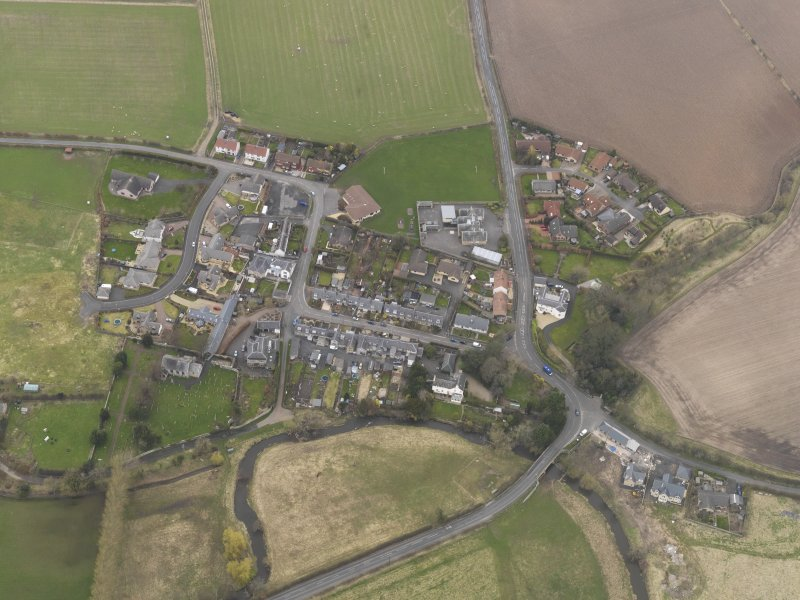 Oblique aerial view centred on the village, taken from the SSE.