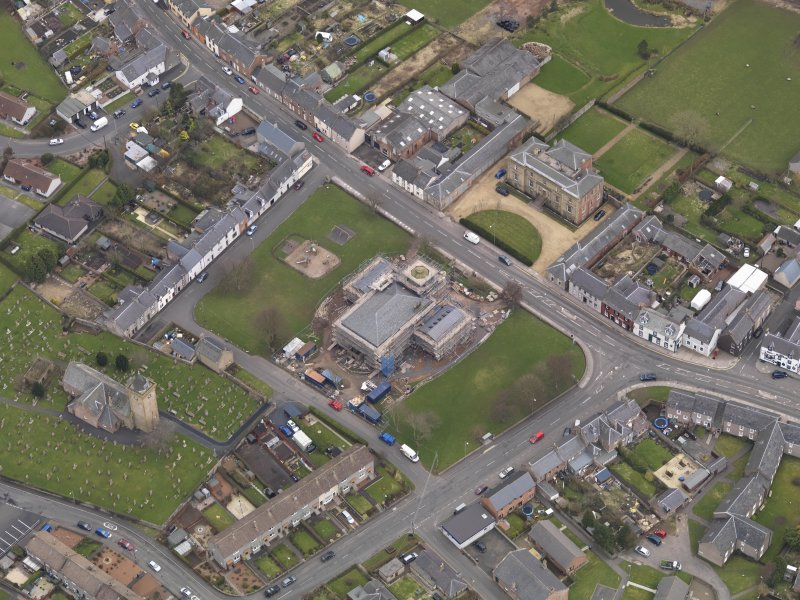 Oblique aerial view centred on the town hall, taken from the NW.