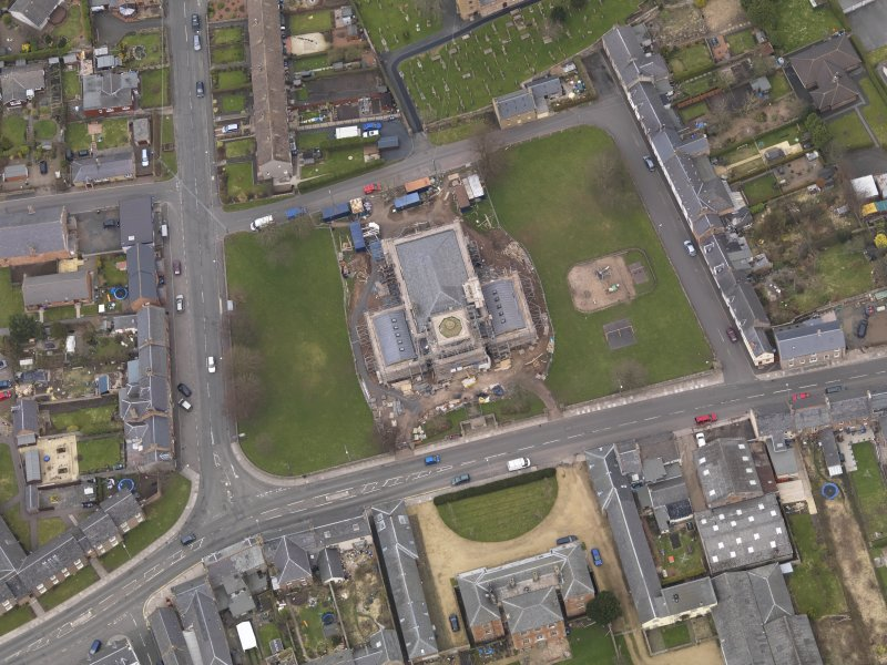 Oblique aerial view centred on the town hall, taken from the S.