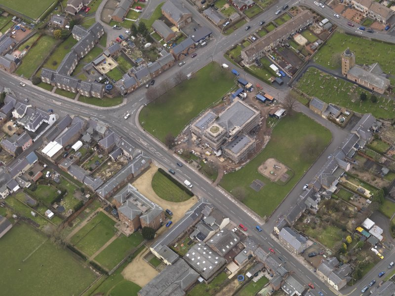 Oblique aerial view centred on the town hall, taken from the SE.