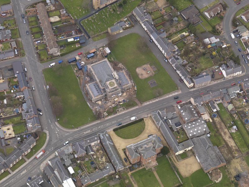 Oblique aerial view centred on the town hall, taken from the SW.