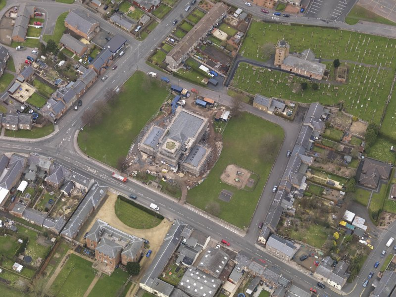 Oblique aerial view centred on the town hall, taken from the SSE.