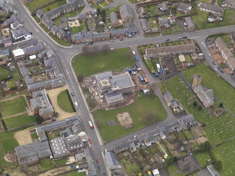 Oblique aerial view centred on the town hall, taken from the E.