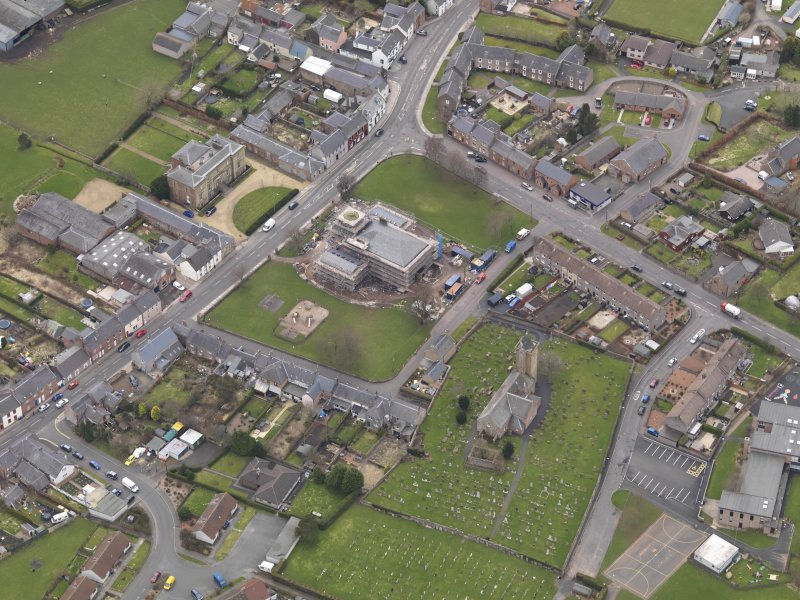 Oblique aerial view centred on the town hall, taken from the NE.