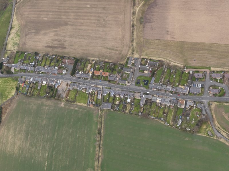 Oblique aerial view centred on the village, taken from the SE.