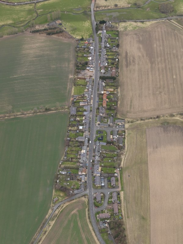 Oblique aerial view centred on the village, taken from the ENE.