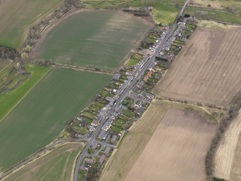 Oblique aerial view centred on the village, taken from the NE.