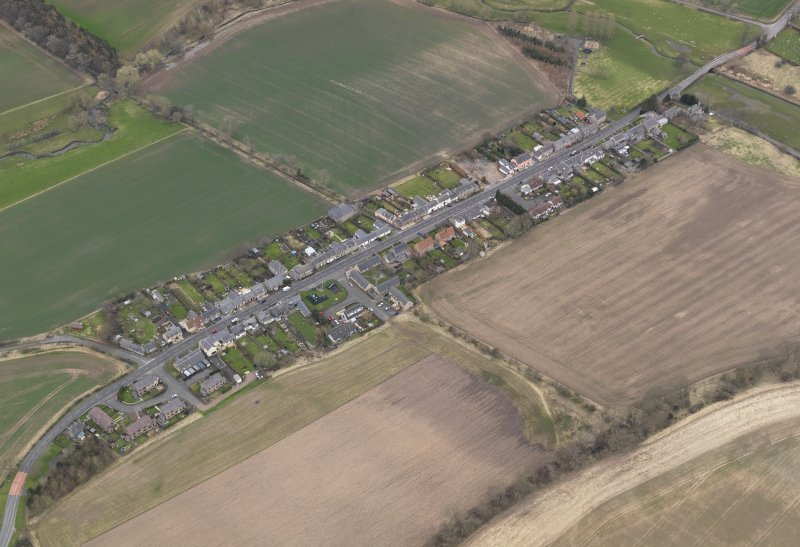 Oblique aerial view centred on the village, taken from the NNE.