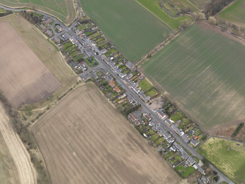 Oblique aerial view centred on the village, taken from the NW.