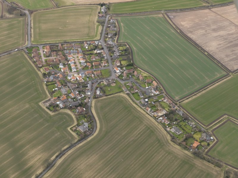 Oblique aerial view centred on the village, taken from the ESE.
