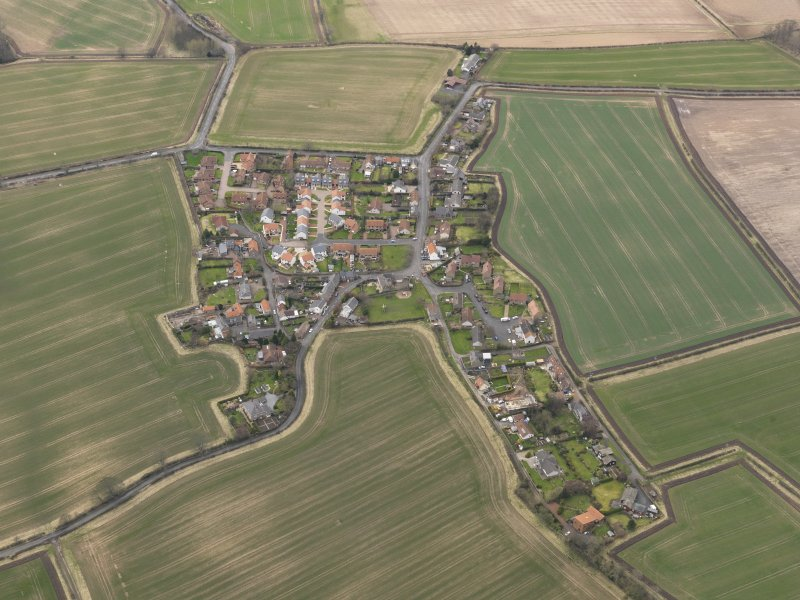 Oblique aerial view centred on the village, taken from the E.