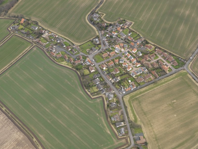 Oblique aerial view centred on the village, taken from the WNW.