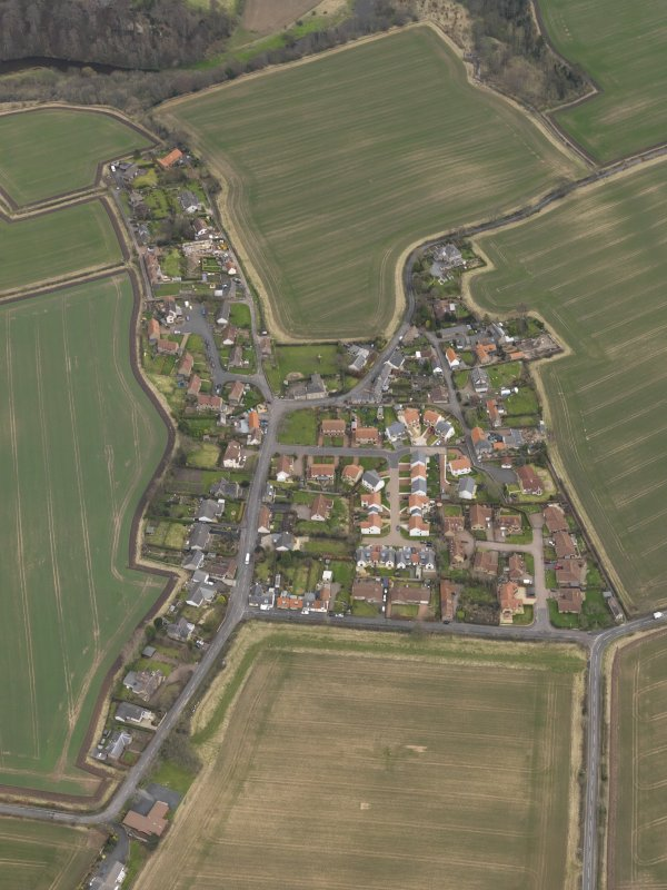 Oblique aerial view centred on the village, taken from the W