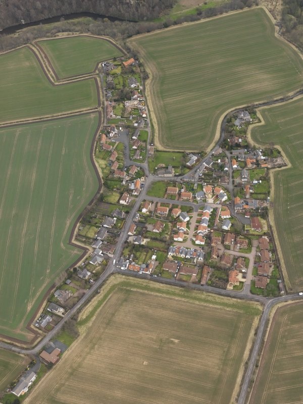 Oblique aerial view centred on the village, taken from the W.