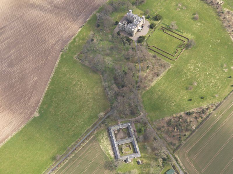 Oblique aerial view centred on the country house with the Home Farm adjacent,  taken from the W.