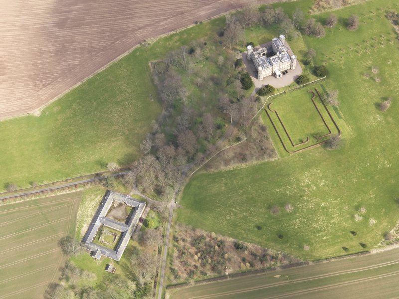 Oblique aerial view centred on the country house with the Home Farm adjacent,  taken from the WSW.