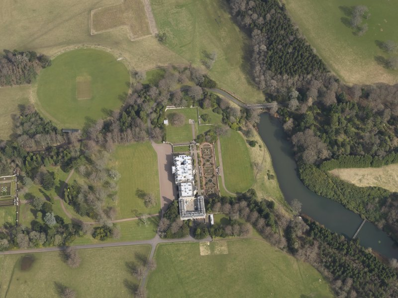 Oblique aerial view centred on the country house with the formal garden adjacent, taken from the WSW.