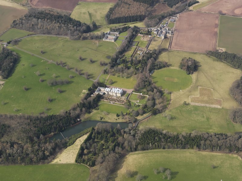 General oblique aerial view centred on the country house with the policies adjacent, taken from the SE.