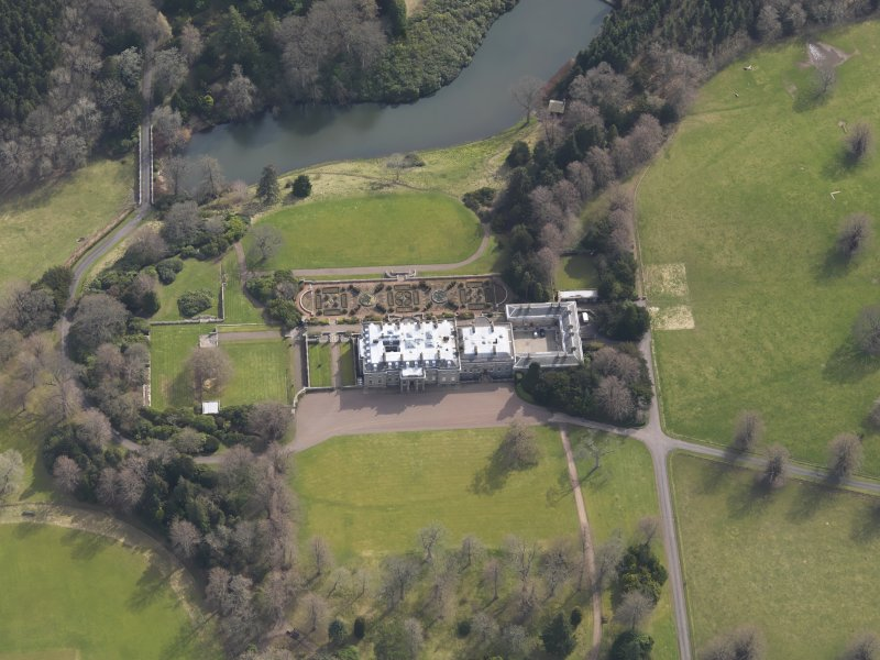 Oblique aerial view centred on the country house with the formal garden adjacent, taken from the NNW.