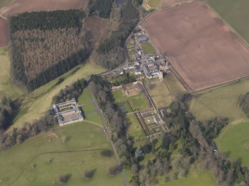 Oblique aerial view centred on the stable block with Buxley adjacent, taken from the S.
