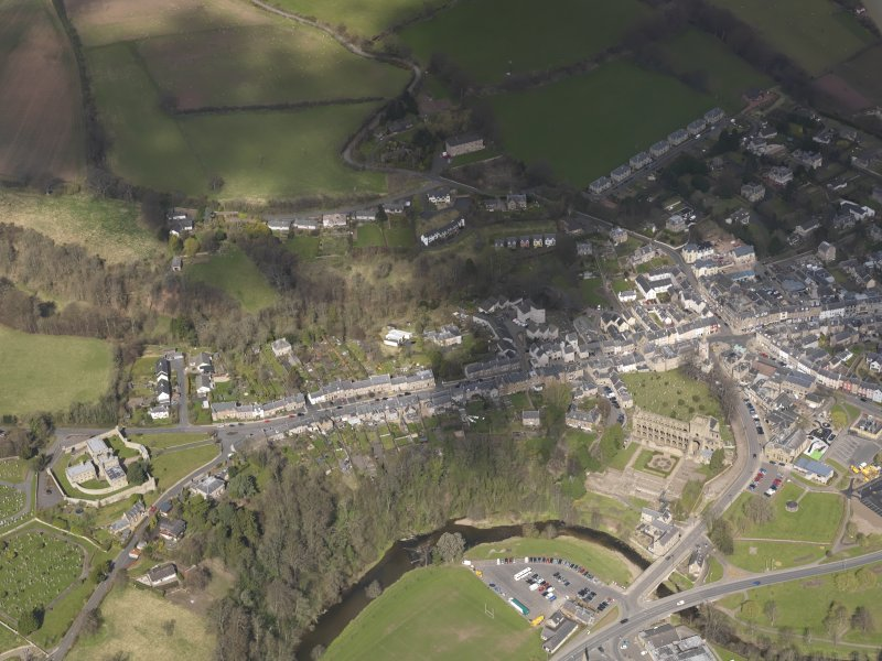 Oblique aerial view centred on the High Street, taken from the S.