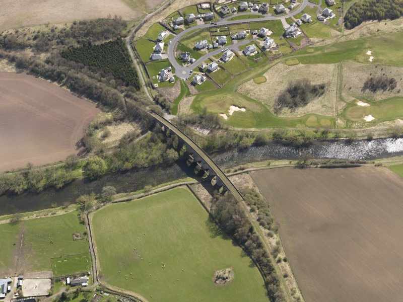 Oblique aerial view centred on the railway viaduct, taken from the WNW.