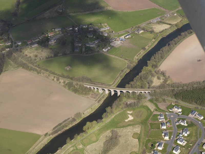 Oblique aerial view centred on the railway viaduct, taken from the SE.