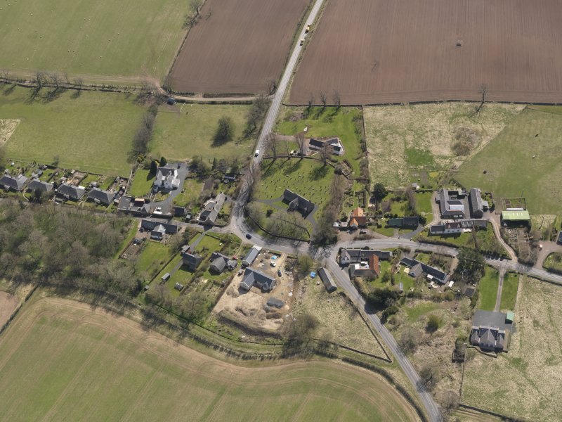 Oblique aerial view centred on the village taken from the NW.