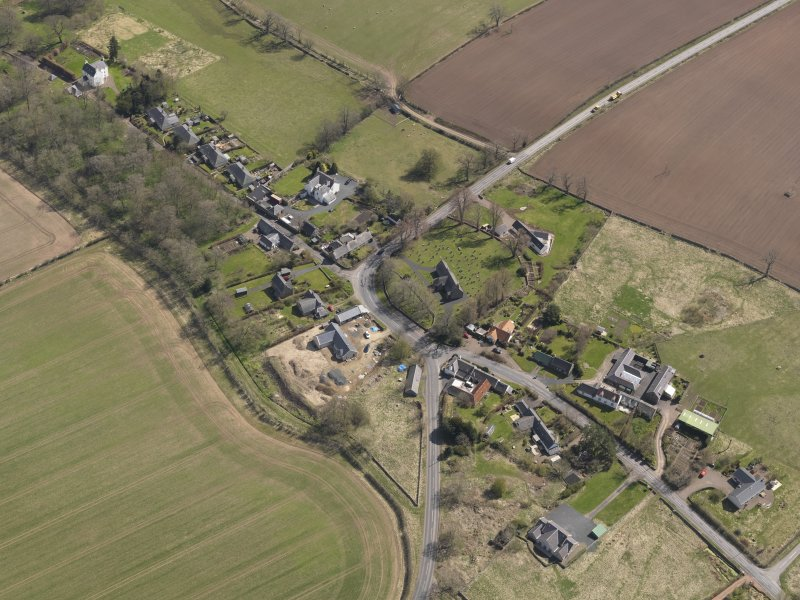 Oblique aerial view centred on the village taken from the WNW.