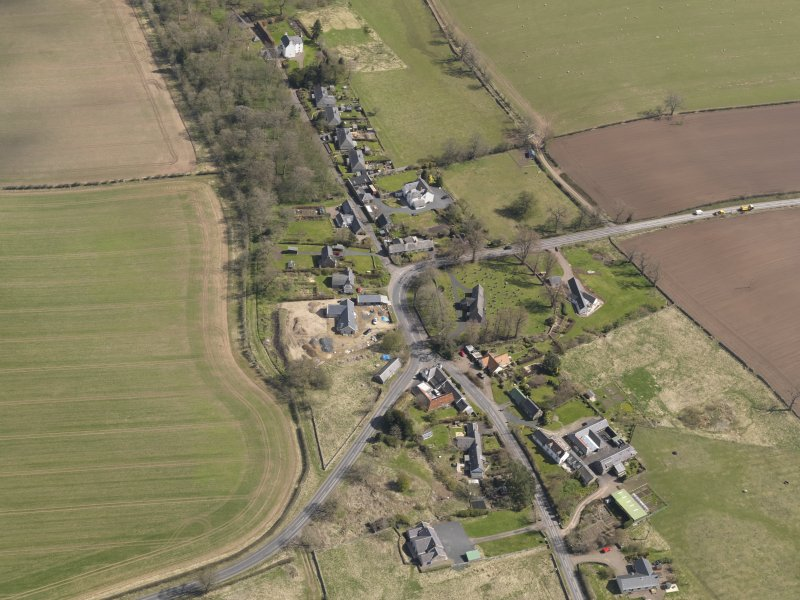 Oblique aerial view centred on the village taken from the W.