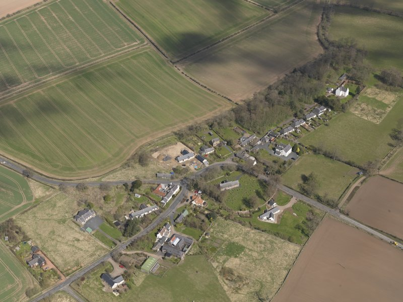 Oblique aerial view centred on the village taken from the SW.