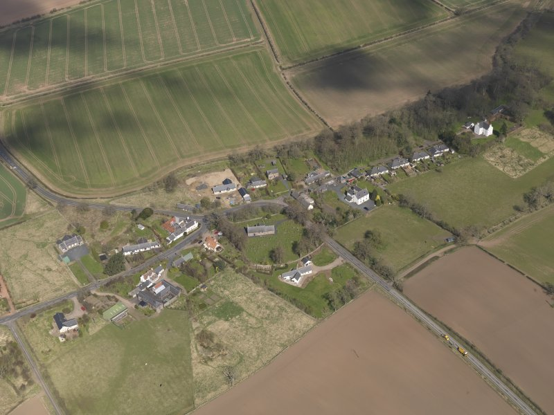 Oblique aerial view centred on the village taken from the SSW.