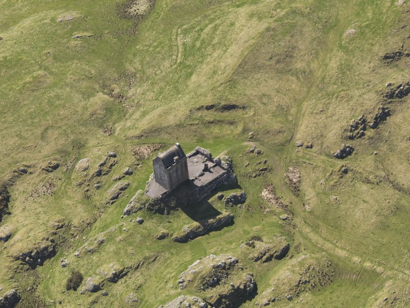 Oblique aerial view centred on the tower-house, taken from the NNE.