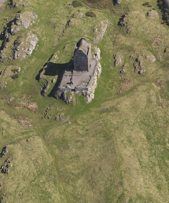 Oblique aerial view centred on the tower-house, taken from the SW.