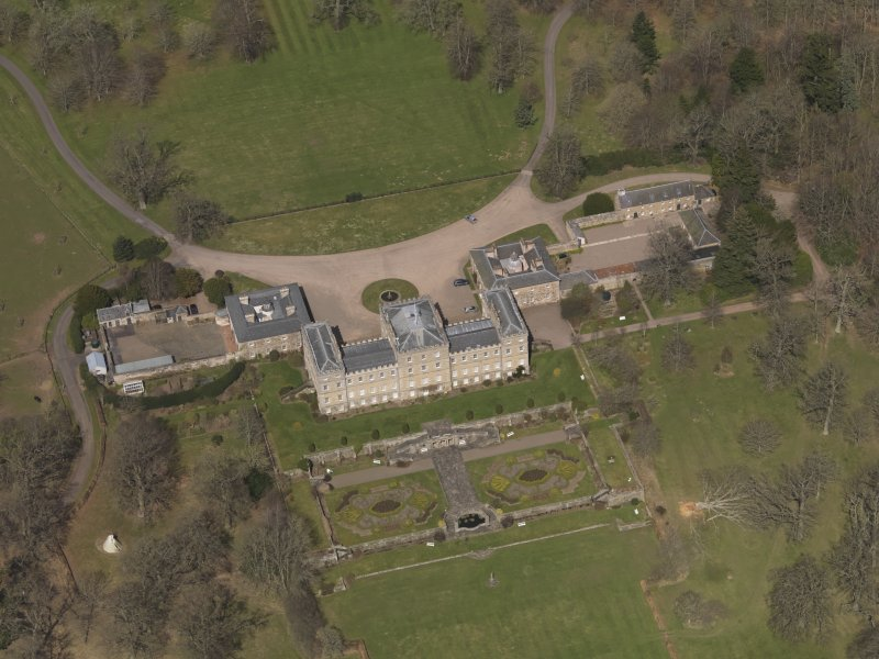 Oblique aerial view centred on Mellerstain House, the Scottish Borders, with the stable block adjacent, taken from the SSE.