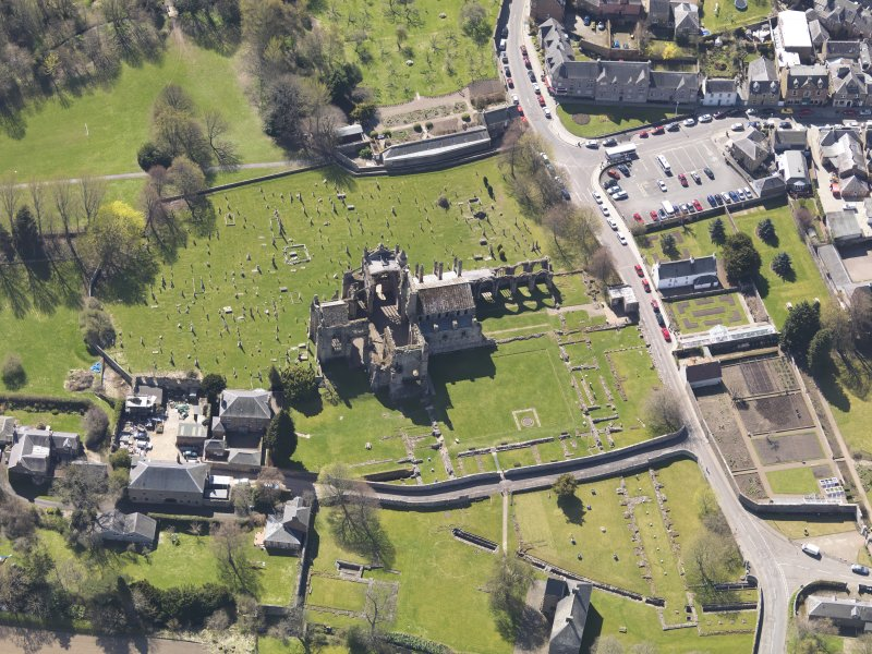 Oblique aerial view centred on Melrose Abbey, taken from the NNE.