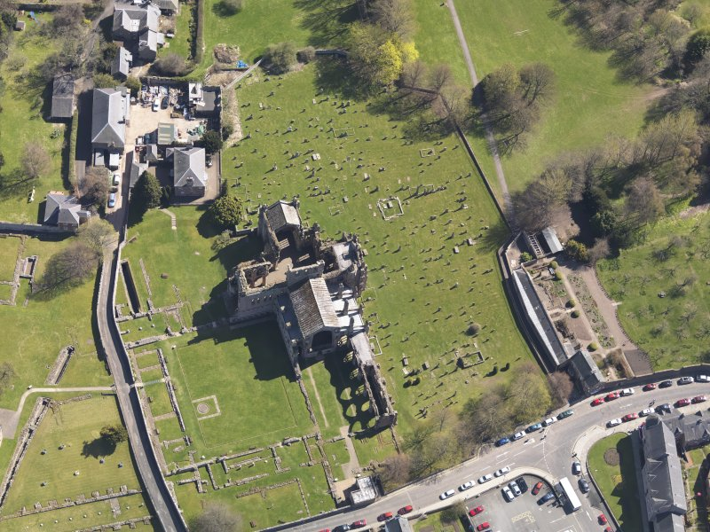 Oblique aerial view centred on the abbey, taken from the W.