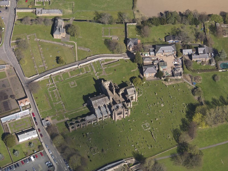 Oblique aerial view centred on the abbey, taken from the SW.