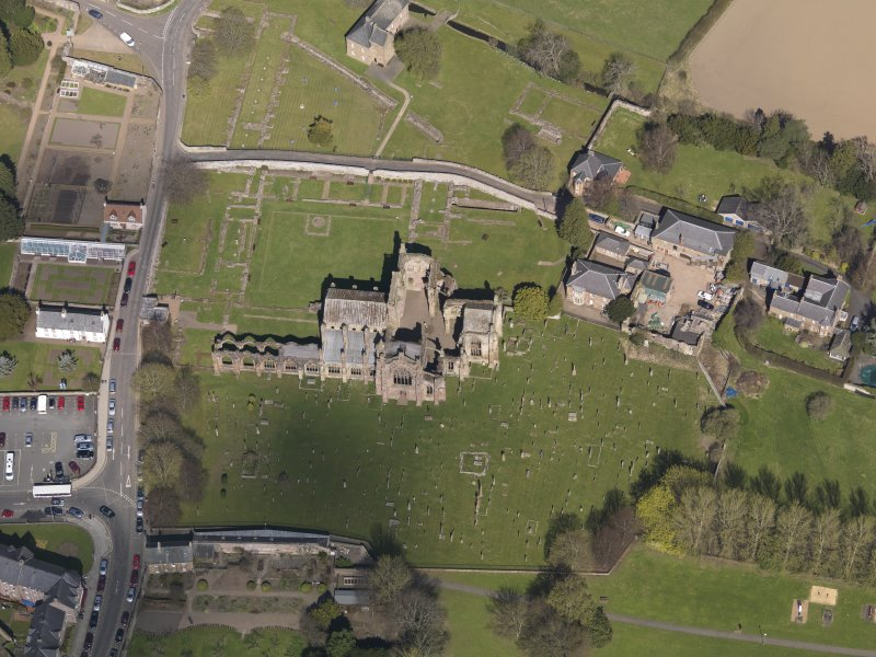 Oblique aerial view centred on the abbey, taken from the S.
