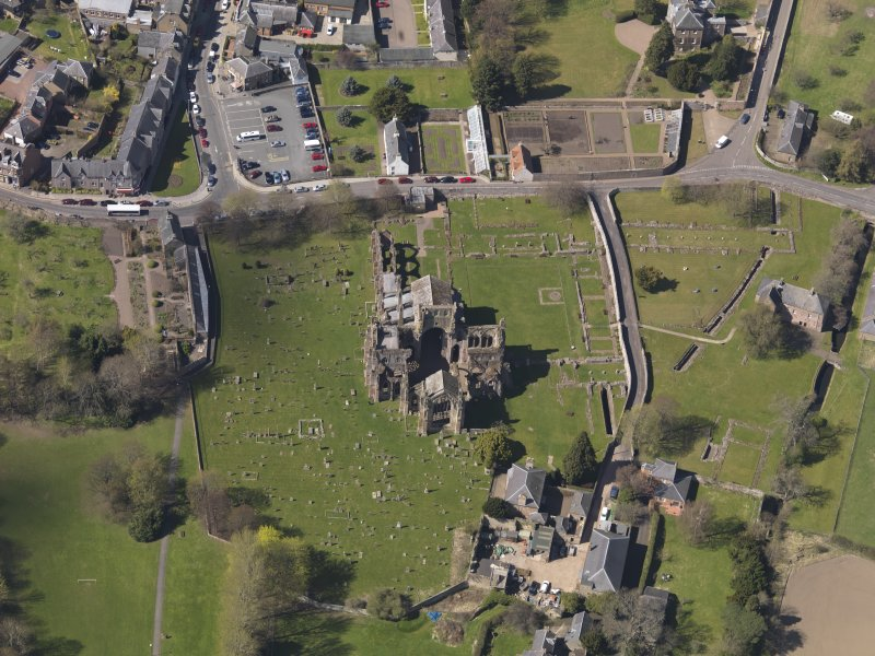 Oblique aerial view centred on the abbey, taken from the E.