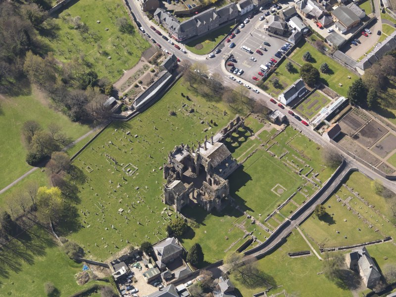 Oblique aerial view centred on the abbey, taken from the NE.