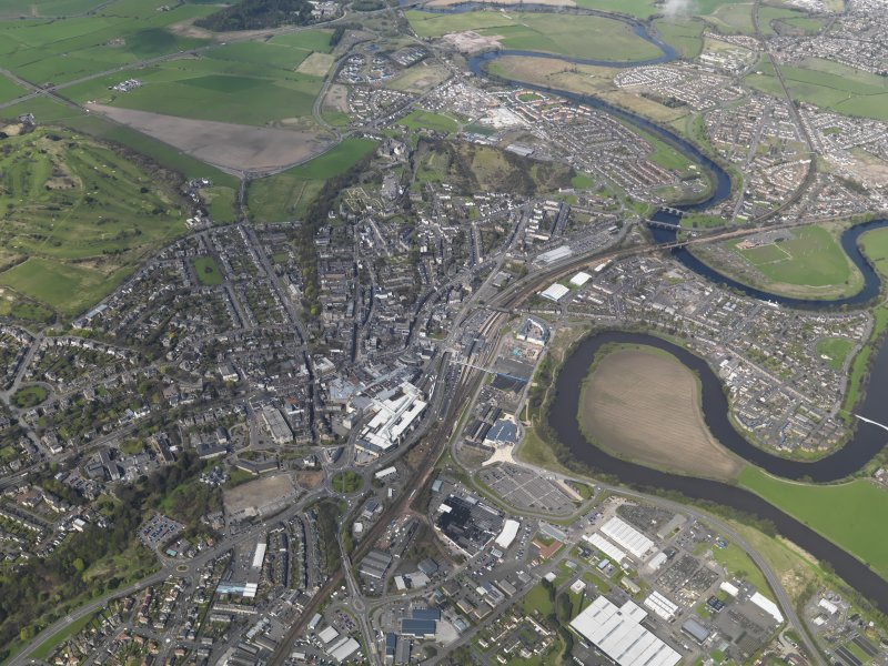 General oblique aerial view of Stirling centred on the railway station, taken from the S.