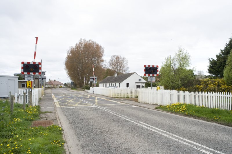 View from SE showing the modern level crossing.